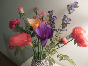 I created this silk flower arrangement as a way to bring a bit of the feeling of spring to my home.
